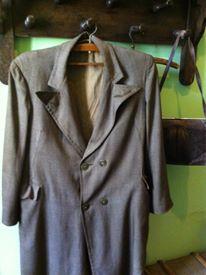 Akhmatova's coat hangs in her flat in the House on the Fontanka